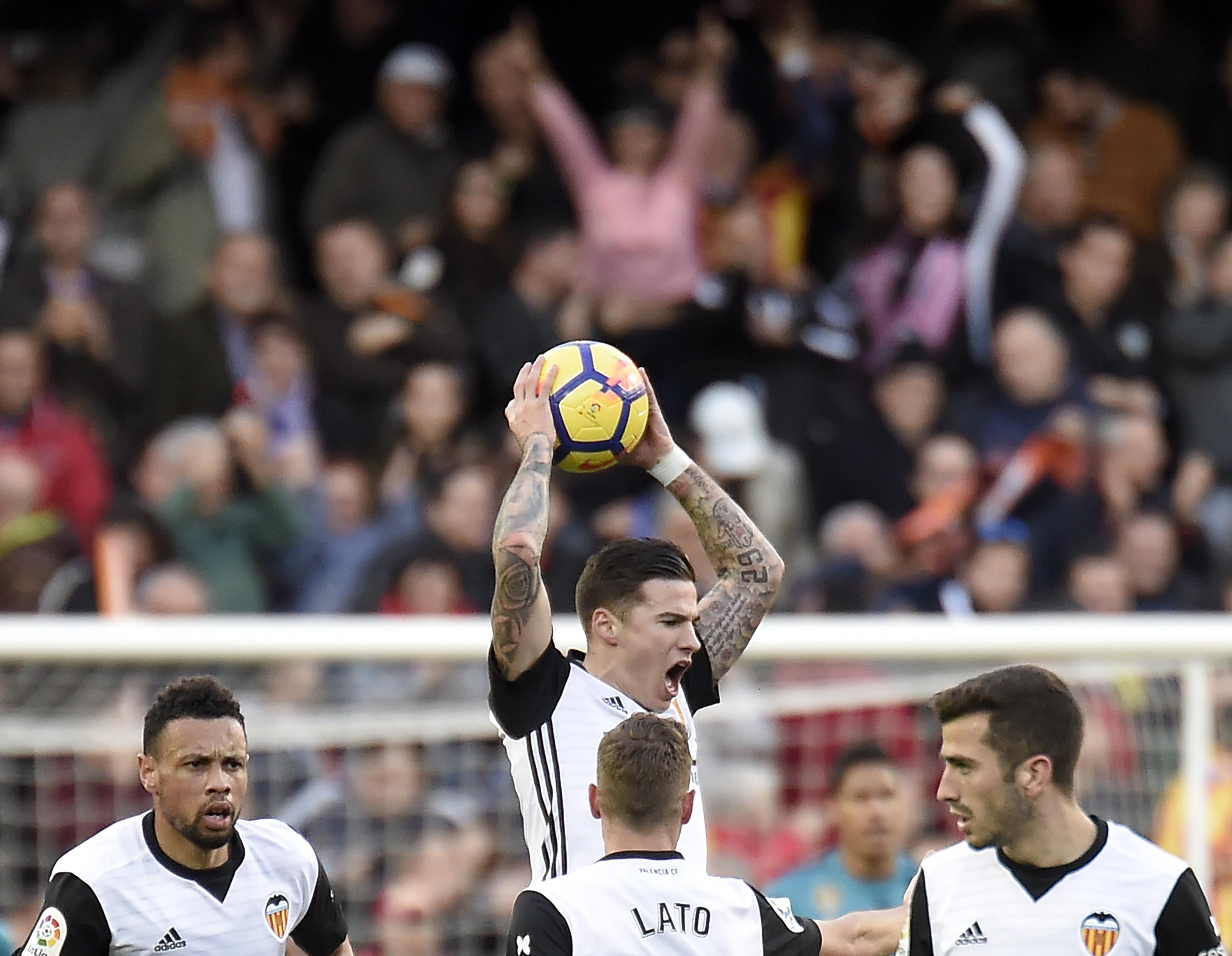 Valencia celebrate against Real Madrid