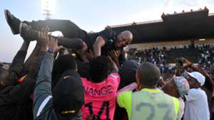 Black Leopards players celebrate with Joel Masutha