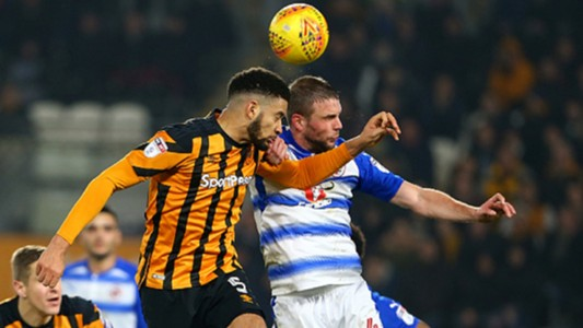Michael Hector of Hull City wins a header as Joey van den Berg of Reading