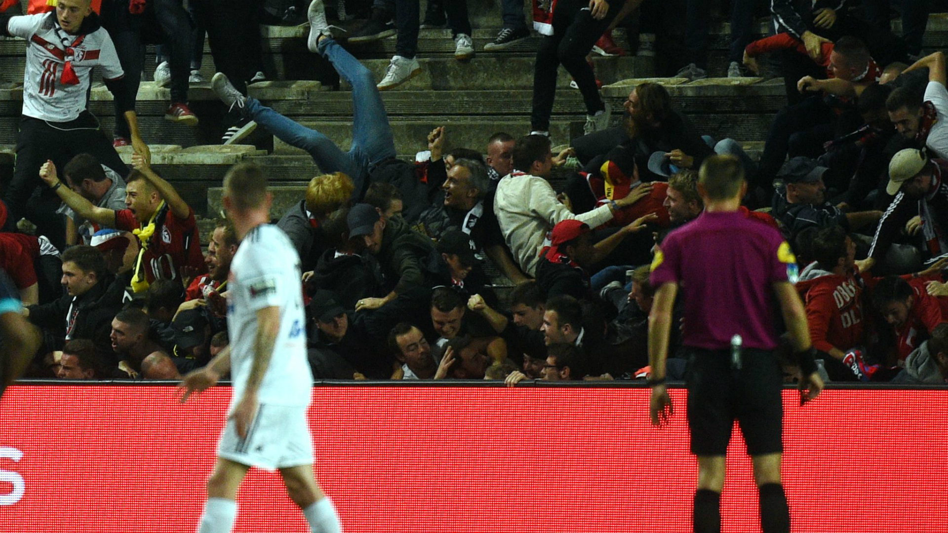 Fans taking pictures with cell phone behind barrier stock photo - Amiens Lille Barrier Collapse