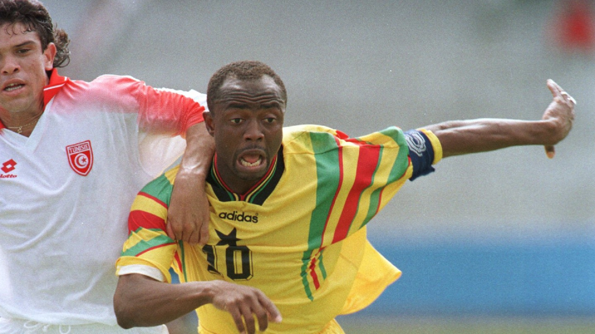 Ghana's Abedi Pele chases the ball during Ghana's 2-1 victory today at Port Elizabeth in the First round of the 1996 African Cup of Nations