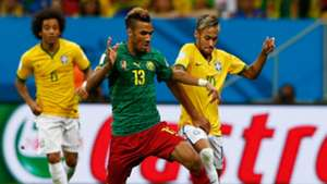 Maxim Choupo-Moting of Cameroon battles with Neymar of Brazil during the 2014 FIFA World Cup Brazil