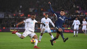 Jordan Ayew Swansea City and Dele Alli of Tottenham Hotspur