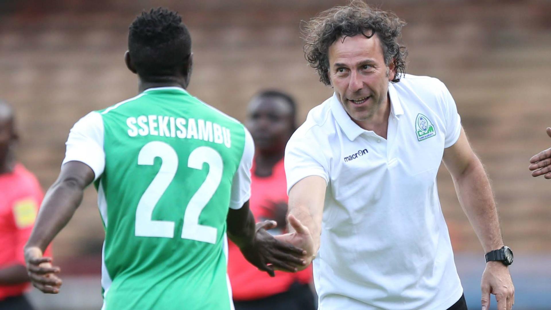 Ugandan striker Erisa Ssekisambu and Gor Mahia coach Hassan Oktay.