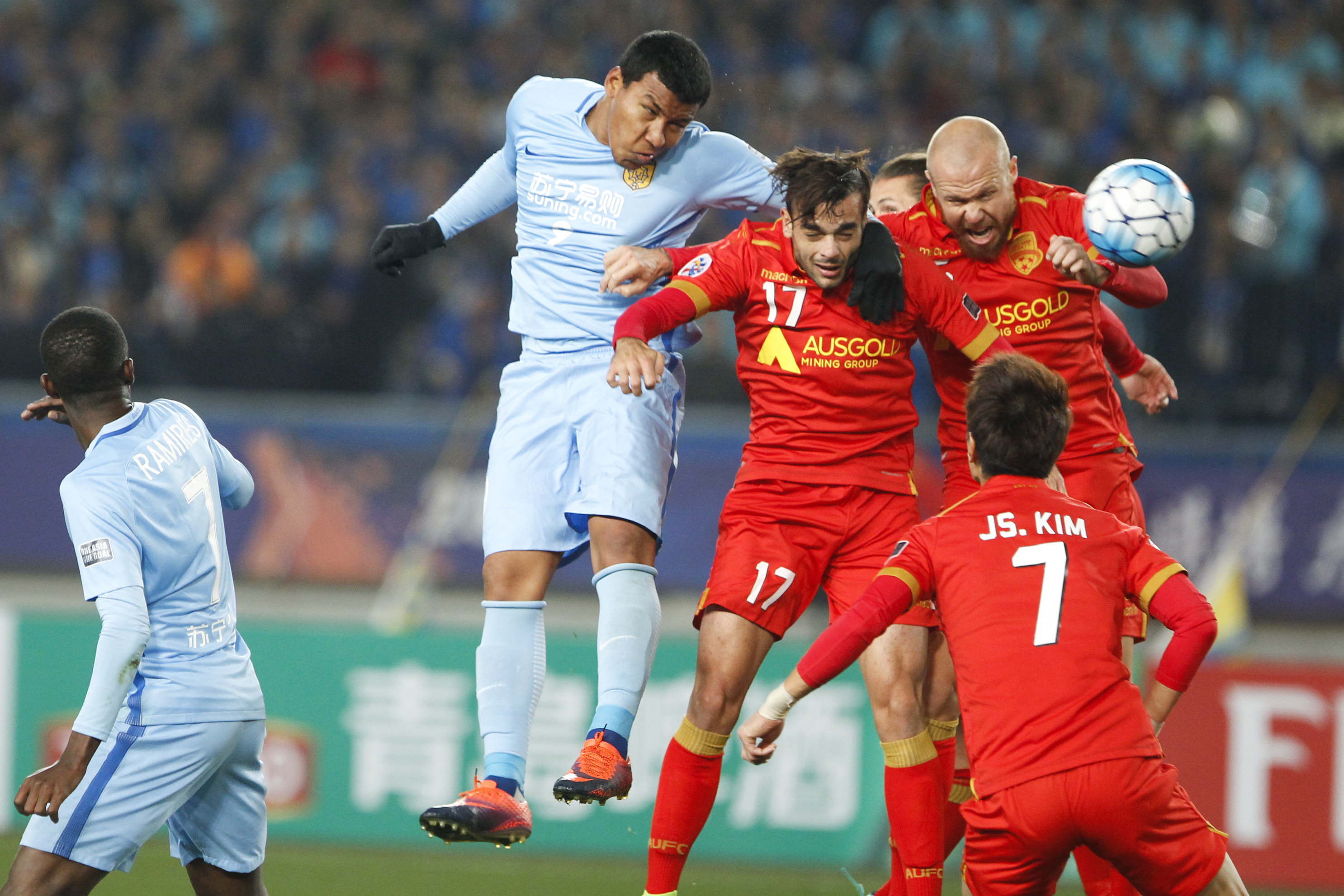 Roger Martinez #9 of Jiangsu Suning and Nikola Mileusnic #17 of Adelaide United compete for the ball during the AFC Champions League 2017 Group H match between Jiangsu Suning and Adelaide United