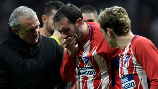 Atletico captain Godin has dental surgery after losing teeth in clash with Neto