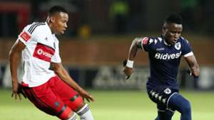 Gabadinhno Mhango of Bidvest Wits challenged by Happy Jele of Orlando Pirates
