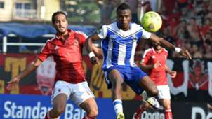 Egyptian's Al Ahly player Saed Ebib Waleed (L) vies with Sewe Sport player Ngoran Kouadio (R)