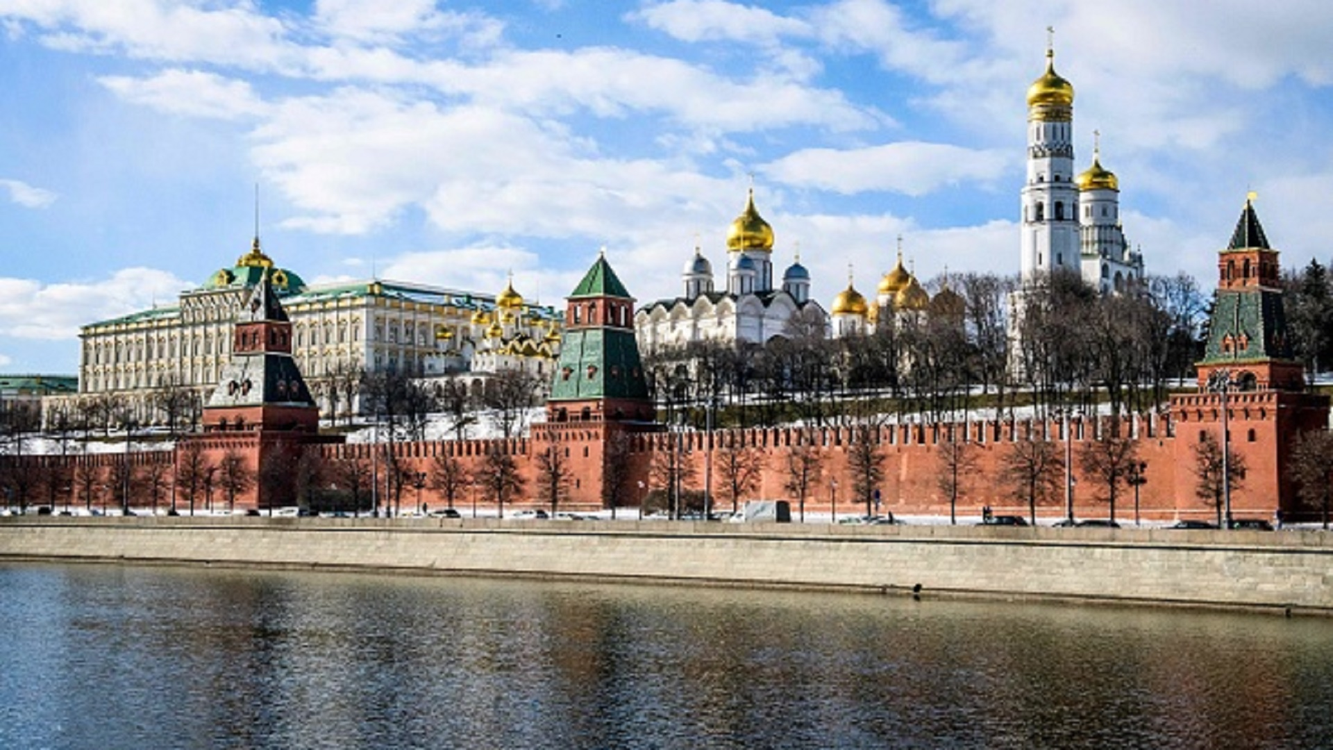 A view of the Moskva river and the Kremlin towers and cathedrals in Moscow