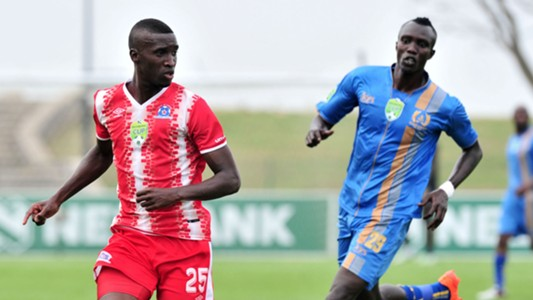 Siyanda Xulu of Maritzburg United challenged by Mame Niang of Royal Eagles