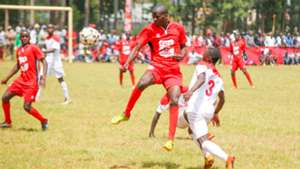 Issa Okumu from St Peters- Mumias heads the ball from Glen Kayumba (in white) from Upper Hill School.