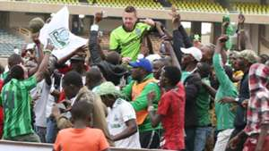 Gor Mahia fans with coach Dylan Kerr v AFC Leopards.