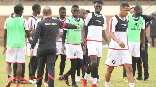 Harambee Stars coach Sebastien Migne and Jesse Were.