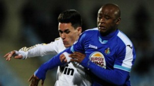 Real Madrid's midfielder Jose Maria Callejon (L) vies with Getafe's South African defender Tshepo Masilela (R)