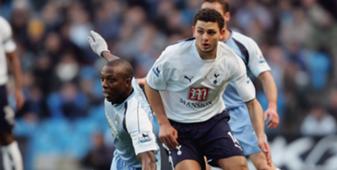Hossam Ghaly of Tottenham is challenged by Hatem Trabelsi of Manchester  حسامم غالي وحاتم الطرابلسي في الدوري الانجليزي
