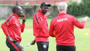 Harambee Stars coach Paul Put and Stanley Okumbi