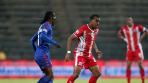 Reneilwe Letsholonyane of SuperSport United challenges by Deolin Mekoa of Maritzburg United