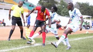 G-Kaweesa Hood (L) of Uganda takled by Atak Luok of Burundi.