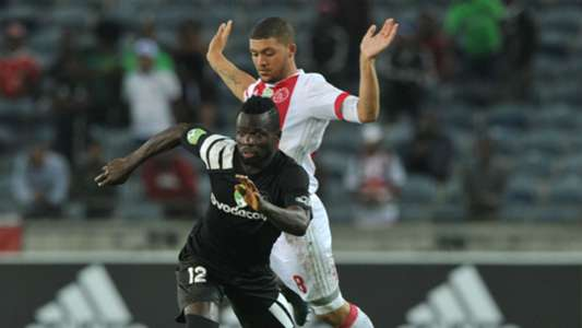 Bernard Morrison of Orlando Pirates is challenged by Grant Margerman of Ajax Cape Town