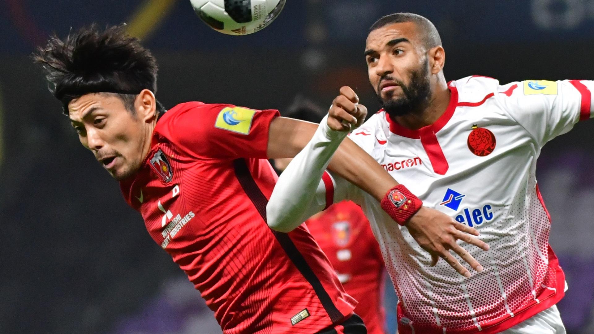Ismail El Haddad of Wydad Casablanca and Ryota Moriwaki of Urawa Reds