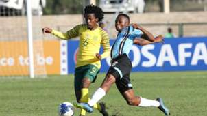Kamohelo Mahlatsi of South Africa challenged by Mothusi Johnson of Botswana