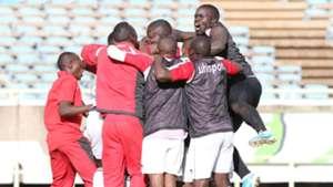Ulinzi Stars players mob keeper James Saruni.
