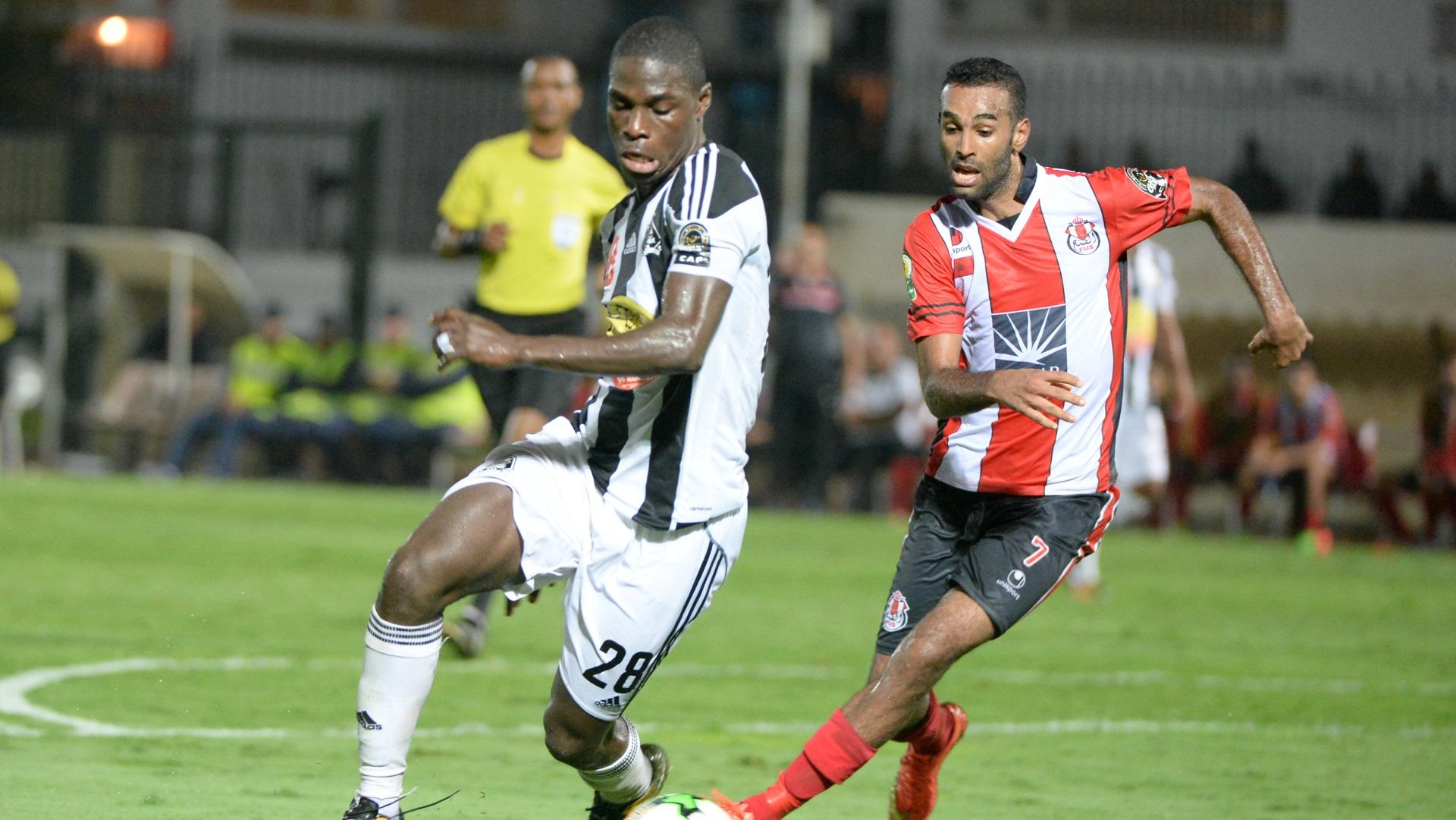 Ben Malango of Tout Puissant Mazembe, Badr Boulhroud of FATH Union Sport