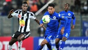 Ben Ngita of TP Mazembe challenged by Clayton Daniels of Supersport United