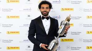 Mohamed Salah of Liverpool poses with the 2018 PFA Player Of The Year Award trophy at the Grosvenor House Hotel in London