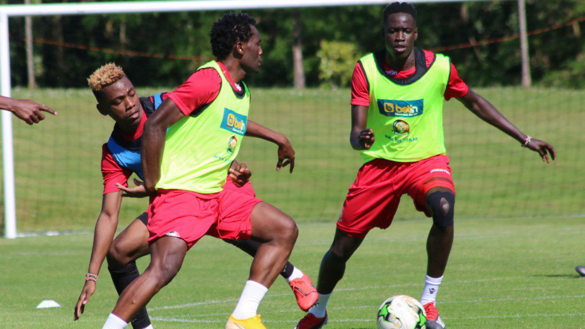 Harambee Stars defenders Aboud Omar and David Owino.