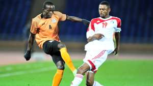 Adrian Chama of Zambia challenged by Mohamed Ahmed Bashir Bisha of Sudan.