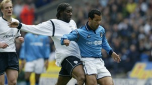 Jay-Jay Okocha of Bolton and Ali Benarbia of Man City
