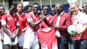 William Ruto with Kenya players Victor Wanyama.