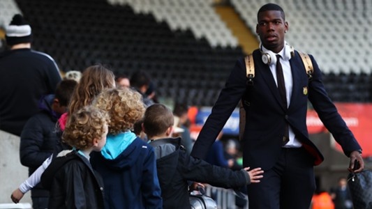 Paul Pogba with young MU fans
