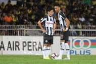 Pahang's Joseph Kalang Tie (left) and Ahmad Syamim Yahya playing against Perak 21/1/2017