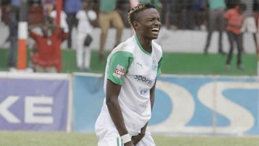 Gor Mahia new signing Kenneth Muguna reacts after a hard challenge from Tusker player.