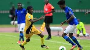 Aduana Stars defender Paul Aidoo (right)