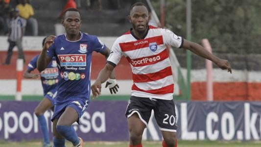 Joseph Mbugi tackles Whyvone Isuza of AFC Leopards.