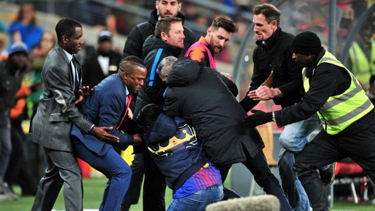 Pitch invader caught while approaching Lionel Messi at the FNB Stadium - Sundowns v Barcelona May 16 2018
