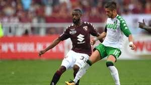 Nicolas Nkoulou of Torino, Sassuolo's Diego Falcinelli