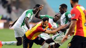 Esperance de Tunis player Khnissi Taha Yassine and Gor Mahia players fight for the ball during the 2018 CAF Champions League