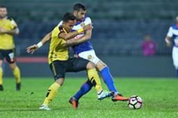 Perak's Shahrom Kalam (Perak) vies for the ball with Kelantan's Mohammed Ghaddar 1/3/2017