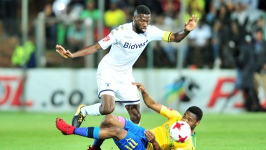 Buhle Mkhwanazi of Bidvest Wits challenged by Sibusiso Vilakazi of Sundowns