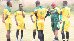 Mathare United coach Francis Kimanzi with players.