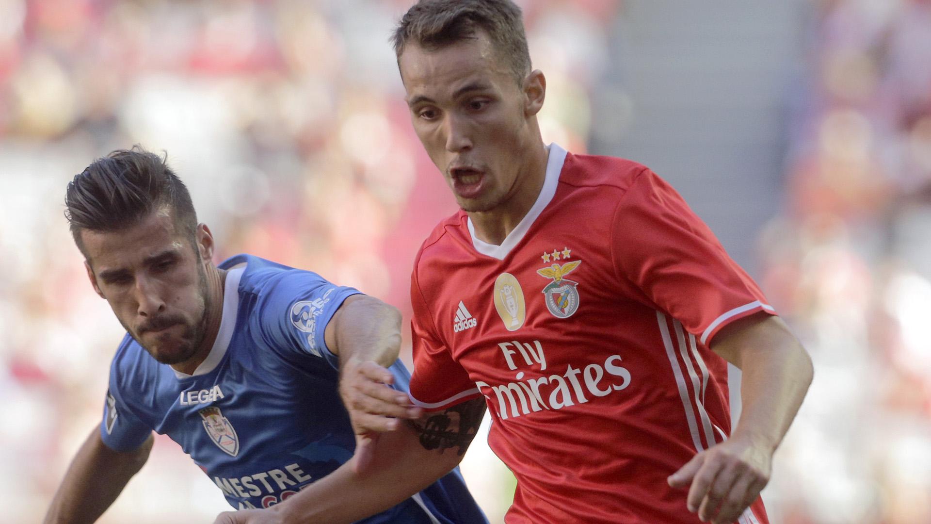 Benfica's Alex Grimaldo (R) with Feirense's Luis Aurelio (L)