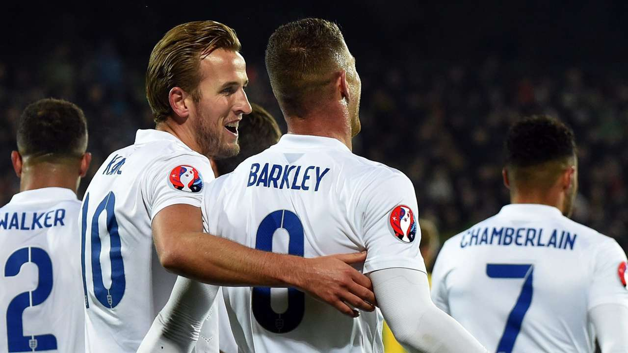 England players celebrate after scoring versus Lithuania