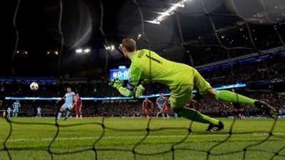 Sergio Aguero for Manchester City against Bayern Munich's Manuel Neuer