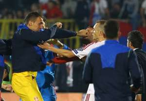 Serbia's Zeljko Brkic punches an Albanian player