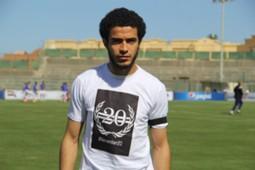 Omar Gaber wearing a shirt Martyrs Zamalek