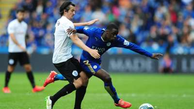 Joey Barton of Queens Park Rangers and Jeffrey Schlupp of Leicester City